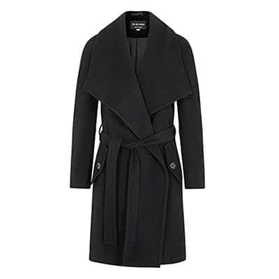 Um casaco de lã é uma opção chique e quente para incluir na sua mala de inverno! Descubra o que mais incluir na sua mala de frio nesse post!
